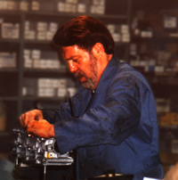 Photo of Wayne Sullivan assembling a head